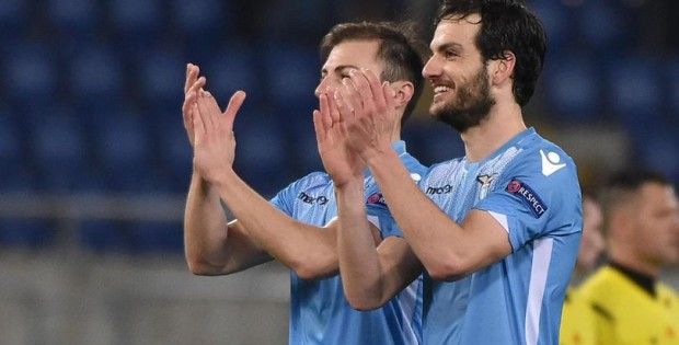 SS Lazio's players Marco Parolo (R) and Stefan Radu celebrates after the UEFA Europa League soccer match between SS Lazio and Galatasaray at the Olimpico stadium in Rome, Italy, 25 February 2016.      ANSA/ETTORE FERRARI