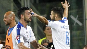 Italy's Graziano Pelle', center, celebrates with his teammate Antonio Candreva after scoring during the Euro 2016 qualifying match between Italy and Malta at the Artemio Franchi stadium in Florence, Italy, Thursday, Sept. 3, 2015. (ANSA/AP Photo/Fabrizio Giovannozzi)